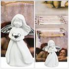 Liten ängel med silverhjärta/silverblomma i Presentpåse